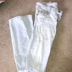 Light wash jeans with holes